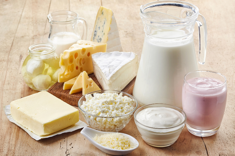 Combination of dairy products are on the wooden table